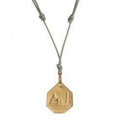 Medalla de plata dorada...